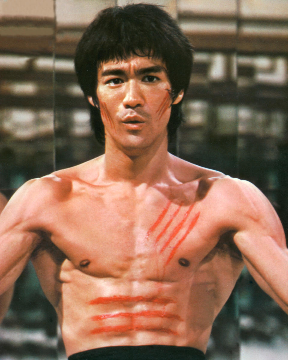 American martial arts star Bruce Lee (1940 - 1973) stars in 'Enter the Dragon', directed by Robert Clouse, 1973. Bloody scratches cover his chest and face. (Photo by Silver Screen Collection/Hulton Archive/Getty Images)