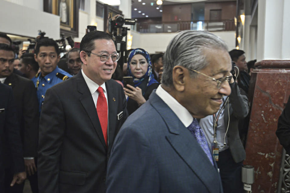 Finance Minister Lim Guan Eng and Prime Minster Tun Dr Mahathir Mohamad arrive in Parliament for the tabling of Budget 2020 on October 11, 2019. — Picture by Shafwan Zaidon