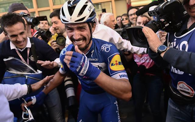 The realisation of winning the first monument of his career appears to sink in toJulian Alaphilippe - AFP or licensors