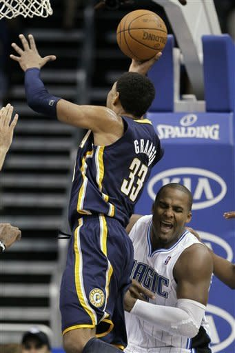 Indiana Pacers' Danny Granger (33) takes a shot and draws a foul from Orlando Magic's Glen Davis, right, during the first half of an NBA basketball game Sunday, March 11, 2012, in Orlando, Fla. (AP Photo/John Raoux)