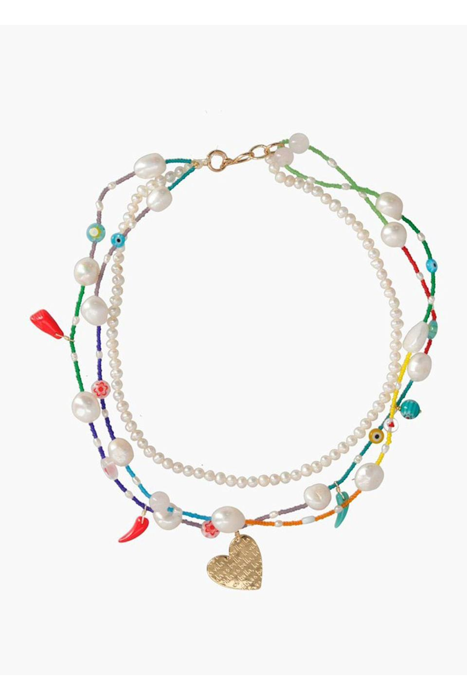 """<p><strong>Mercedes Salazar</strong></p><p>mercedessalazar.com</p><p><strong>$77.00</strong></p><p><a href=""""https://int.mercedessalazar.com/collections/necklaces/products/colorful-life-necklace"""" rel=""""nofollow noopener"""" target=""""_blank"""" data-ylk=""""slk:Shop Now"""" class=""""link rapid-noclick-resp"""">Shop Now</a></p><p>This necklace by Mercedes Salazar is handmade by master artisans in Bogotá, Colombia. Consider it the layered look will complete a casual summer outfit. </p>"""