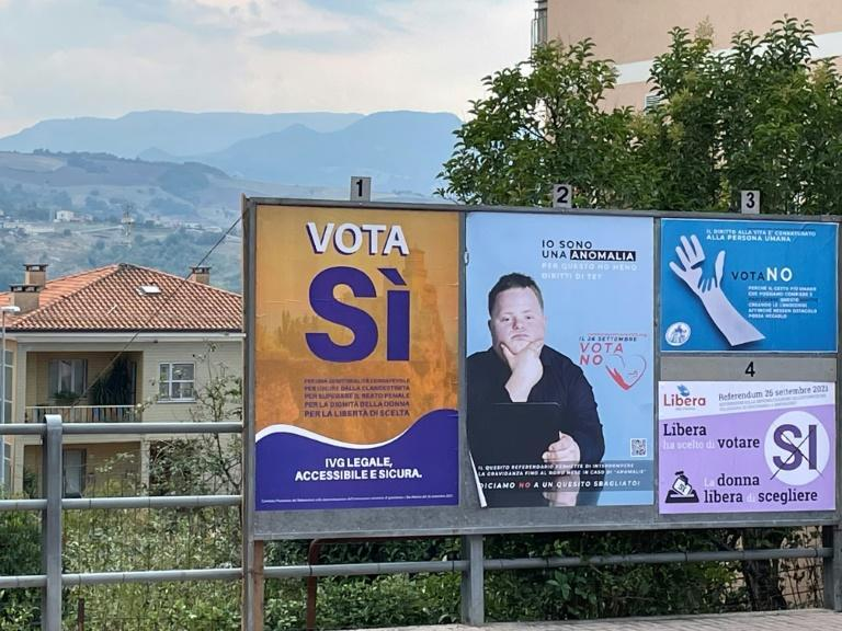 A billboard showing both both pro- and anti-abortion posters in San Marino ahead of the abortion referendum (AFP/Brigitte HAGEMANN)