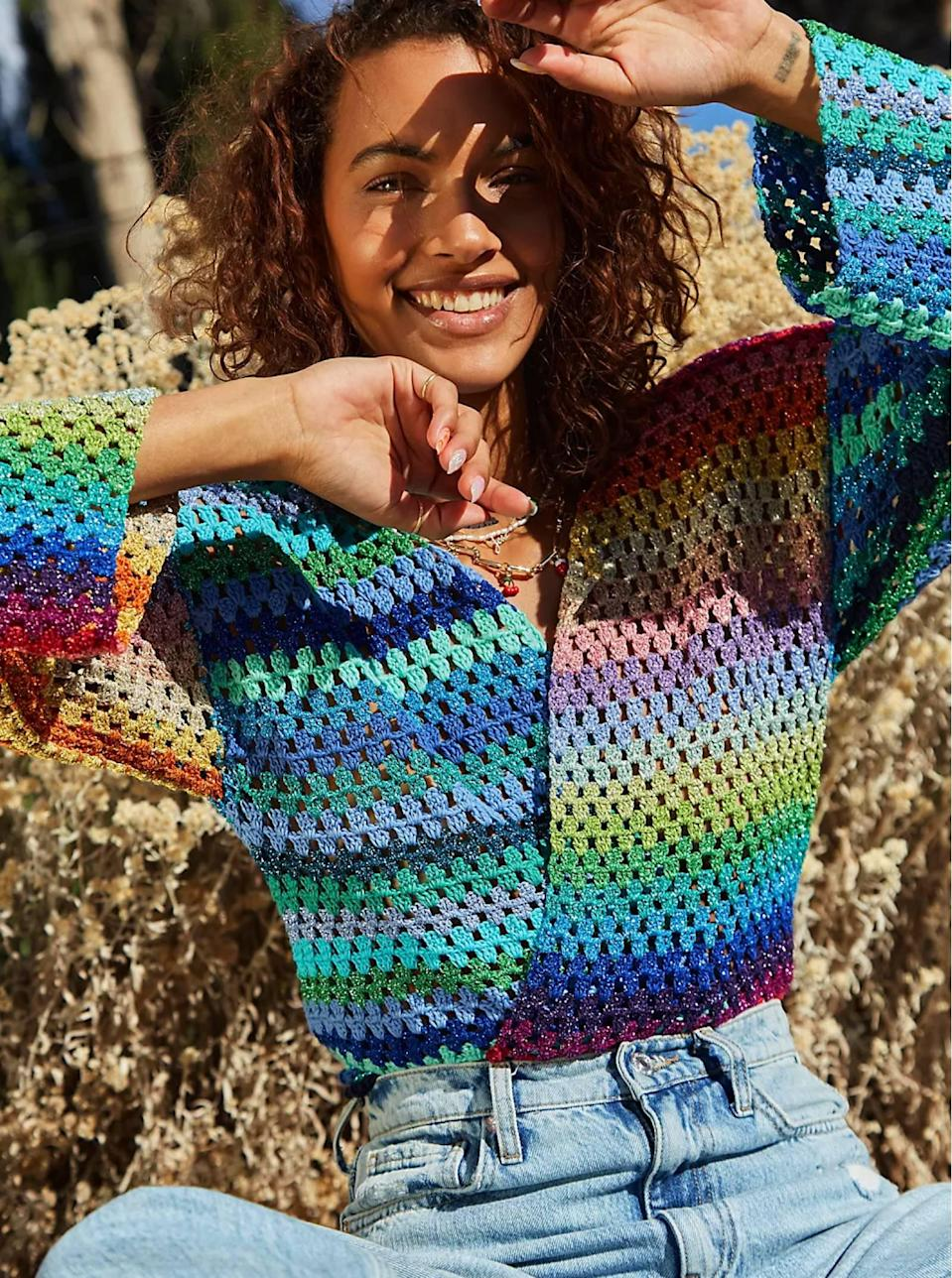 """Lastly, a shimmery rainbow number that will make your daily vintage denim anything but boring. $750, Free People. <a href=""""https://www.freepeople.com/shop/rose-carmine-crochet-cardigan/?"""" rel=""""nofollow noopener"""" target=""""_blank"""" data-ylk=""""slk:Get it now!"""" class=""""link rapid-noclick-resp"""">Get it now!</a>"""