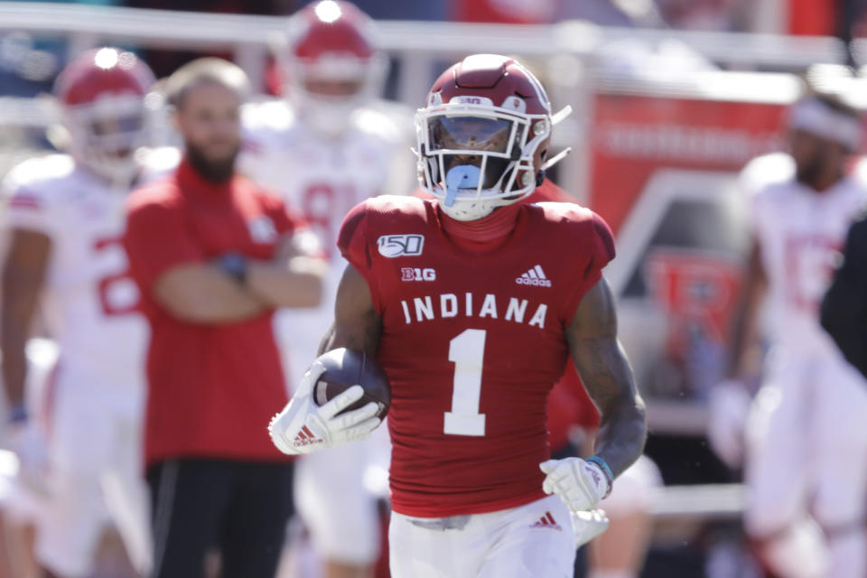 In this photo taken on Saturday, Oct. 12, 2019, Indiana wide receiver Whop Philyor (1) runs during the first half of an NCAA college football game against Rutgers, in Bloomington, Ind. The Hoosiers could be headed to a second straight bowl game despite a brutal schedule that begins with Penn State visiting Bloomington, Indiana, on Oct. 24.(AP Photo/Darron Cummings)