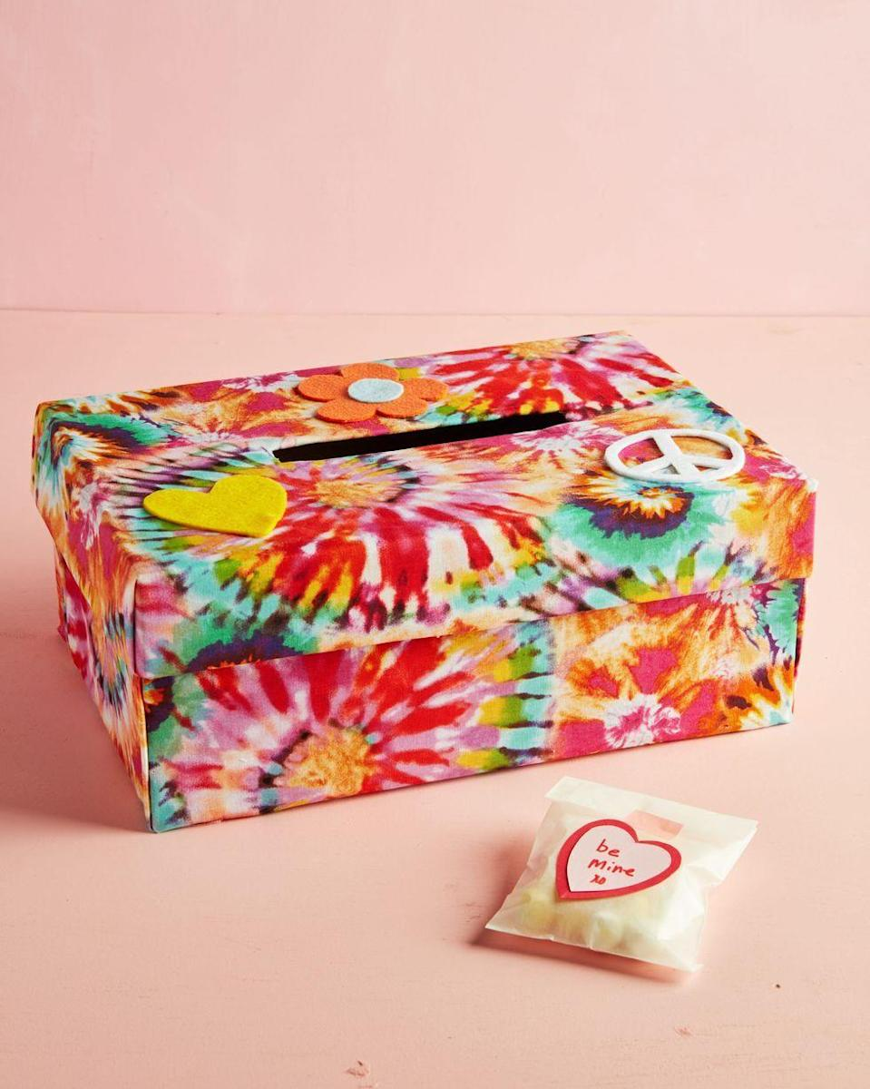 """<p>News flash: Tie dye is cool again. This fabric-wrapped box, decorated with peace signs and flower power, celebrates all things groovy. </p><p><a class=""""link rapid-noclick-resp"""" href=""""https://www.amazon.com/Premier-Prints-Tie-Dyed-Summer/dp/B00MMNZPTE/?tag=syn-yahoo-20&ascsubtag=%5Bartid%7C10055.g.26066165%5Bsrc%7Cyahoo-us"""" rel=""""nofollow noopener"""" target=""""_blank"""" data-ylk=""""slk:SHOP TIE DYE FABRIC"""">SHOP TIE DYE FABRIC</a></p><p><em><a href=""""https://www.countryliving.com/diy-crafts/g25844424/valentines-day-boxes"""" rel=""""nofollow noopener"""" target=""""_blank"""" data-ylk=""""slk:Get the tutorial at Country Living »"""" class=""""link rapid-noclick-resp"""">Get the tutorial at Country Living »</a></em></p>"""