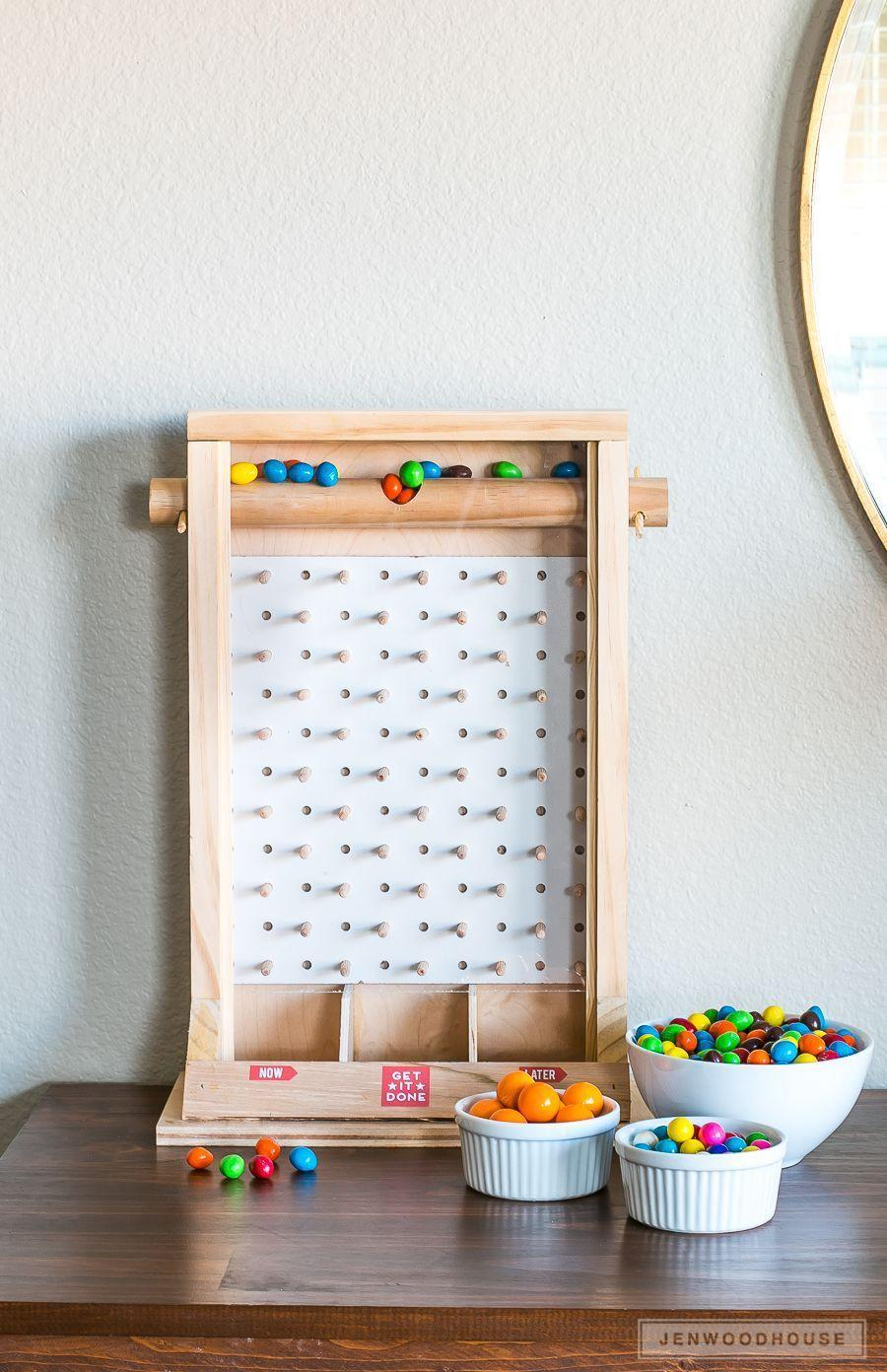 """<p>Know someone with a serious sweet tooth? Let them get their fix with this sophisticated candy dispenser. (We suggest including a selection of the recipient's favorite candies to keep things feeling truly personal.)</p><p><strong>Get the tutorial at <a href=""""https://jenwoodhouse.com/diy-candy-dispenser/"""" rel=""""nofollow noopener"""" target=""""_blank"""" data-ylk=""""slk:The House of Wood"""" class=""""link rapid-noclick-resp"""">The House of Wood</a>.</strong></p><p><a class=""""link rapid-noclick-resp"""" href=""""https://www.amazon.com/Dubble-Bubble-small-gum-balls-Pounds/dp/B018FKARYK?tag=syn-yahoo-20&ascsubtag=%5Bartid%7C10050.g.645%5Bsrc%7Cyahoo-us"""" rel=""""nofollow noopener"""" target=""""_blank"""" data-ylk=""""slk:SHOP GUMBALLS"""">SHOP GUMBALLS</a></p>"""