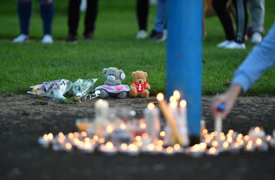 Flowers, soft toys and candles are seen at a vigil at the scene in Chandos Crescent, Killamarsh, near Sheffield, where four people were found dead at a house on Sunday. Picture date: Monday September 20, 2021.