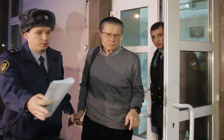 Russian former Economy Minister Alexei Ulyukayev, who was charged with accepting a bribe, is escorted by bailiffs after a court hearing in Moscow