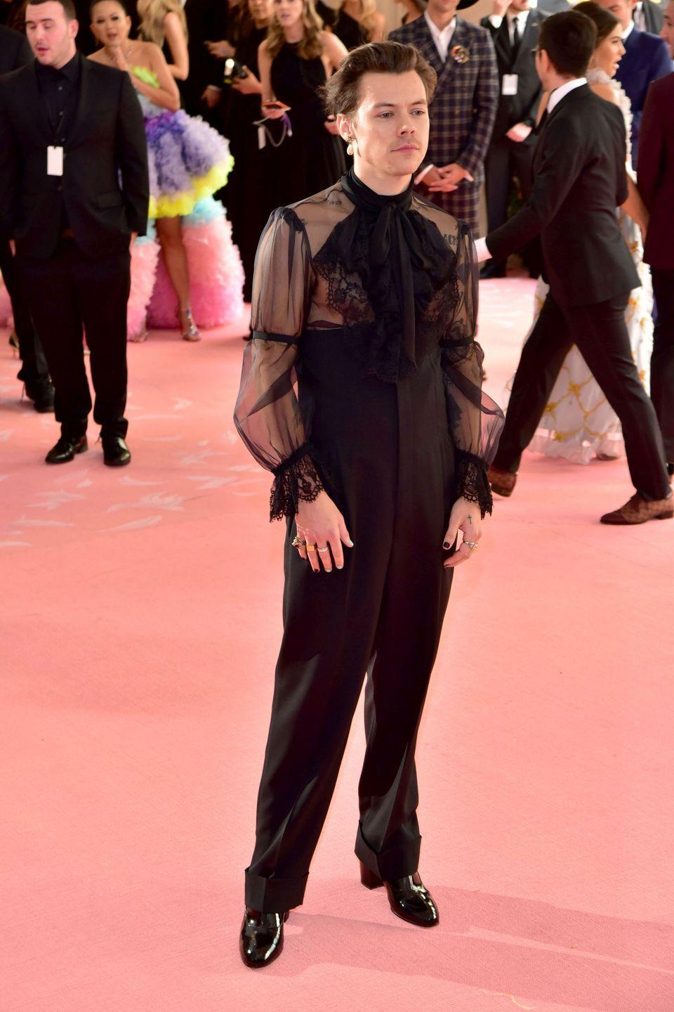 <p>Do you have a friend with a sheer black top you've been low-key eyeing for a while? Pair it with a flowing pair of black trousers and one (1) dangly earring, and you've unlocked the secret to Harry Styles' banger of a look at last year's Met Gala. </p>
