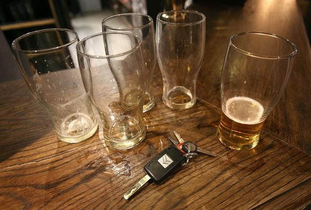 Beer glasses and a set of car keys on a bar (Philip Toscano/PA)