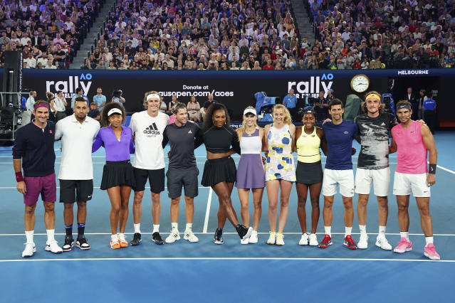 From left, Roger Federer of Switzerland, Nick Kyrgios of Australia, Naomi Osaka of Japan, Alexander Zverev, Dominic Thiem of Austria, Serena Williams of the United States, Caroline Wozniacki of Denmark, Petra Kvitova of the Czech Republic, Coco Gauff of the United States, Novak Djokovic of Serbia, Stefanos Tsitsipas of Greece and Rafael Nadal of Spain pose for a photo during the Rally For Relief at Rod Laver Arena in Melbourne, Wednesday, Jan. 15, 2020. Tennis stars have come together for the Rally for Relief to raise money in aid of the bushfire relief efforts across Australia. (Scott Barbour/AAP Image via AP)