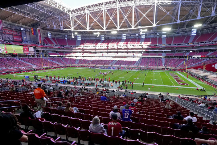 FILE - In this Sunday, Nov. 15, 2020, file photo, the Buffalo Bills and the Arizona Cardinals compete during the first half of an NFL football game in Glendale, Ariz. The San Francisco 49ers are set to embark on an unusual three-week road trip after being kicked out of their stadium and practice facility because of strict new COVID-19 protocols in their home county in Northern California. The Niners will fly to Arizona, where they will practice, live and play their next two games after Santa Clara County imposed a three-week ban on games and practices for contact sports. (AP Photo/Ross D. Franklin, File)