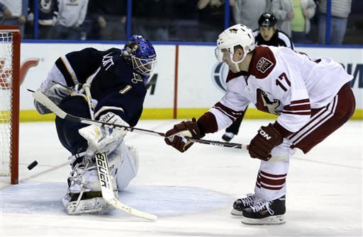 St. Louis Blues goalie Brian Elliott, left, deflects a shot by Phoenix Coyotes' Radim Vrbata, of the Czech Republic, during a shootout of an NHL hockey game on Thursday, April 18, 2013, in St. Louis. The Blues won 2-1. (AP Photo/Jeff Roberson)