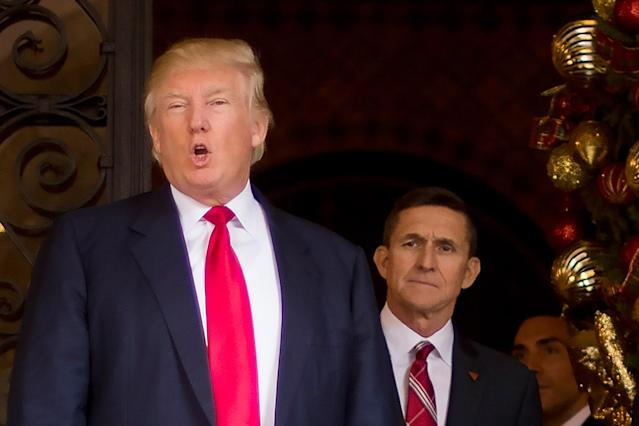 Donald Trump (L) with his former national security advisor Michael Flynn.