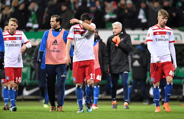 Soccer Football - Bundesliga - Werder Bremen vs Hamburger SV - Weser-Stadion, Bremen, Germany - February 24, 2018 Hamburg's Andre Hahn and team mates look dejected at the end of the match REUTERS/Fabian Bimmer DFL RULES TO LIMIT THE ONLINE USAGE DURING MATCH TIME TO 15 PICTURES PER GAME. IMAGE SEQUENCES TO SIMULATE VIDEO IS NOT ALLOWED AT ANY TIME. FOR FURTHER QUERIES PLEASE CONTACT DFL DIRECTLY AT + 49 69 650050