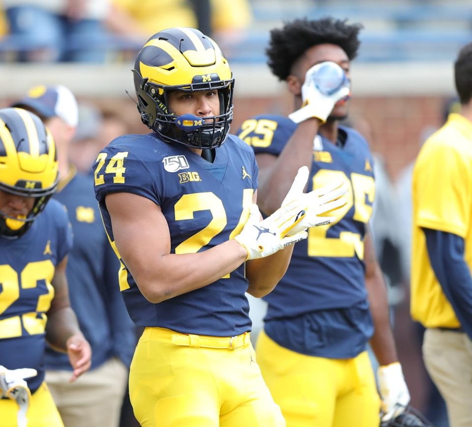 Michigan Wolverines running back Zach Charbonnet warms up before action against the Iowa Hawkeyes on Saturday, Oct. 5, 2019, at Michigan Stadium in Ann Arbor.