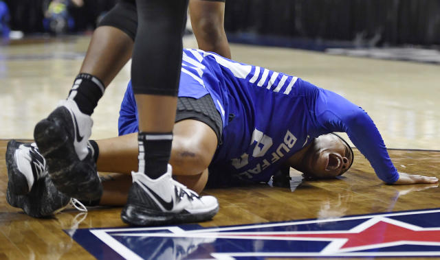 Buffalo's Cierra Dillard cries out after injury during the second half of the team's second-round women's college basketball game against Connecticut in the NCAA tournament Sunday, March 24, 2019, in Storrs, Conn. (AP Photo/Jessica Hill)