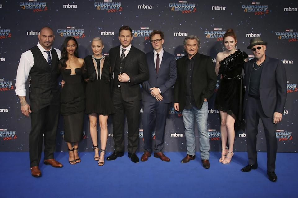 Actors from left, Dave Bautista, Zoe Saldana, Pom Klementieff, Chriss Pratt, director James Gunn, actors Kurt Russell, Karen Gillan and Michael Rooker pose for photographers upon arrival at the premiere of the film 'Guardians of the Galaxy Vol.2 ' in London, Monday, April 24, 2017. (Photo by Joel Ryan/Invision/AP)