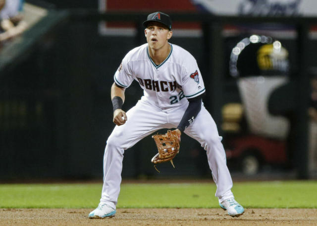 FILE - In this July 20, 2018, file photo, Arizona Diamondback' Jake Lamb plays third base against the Colorado Rockies during a baseball game in Phoenix. With key players still on the roster and new players who should fill at least some of the void, the Diamondbacks are hoping to compete for a playoff spot even with one of baseball's best players on a new team. (AP Photo/Darryl Webb, File)