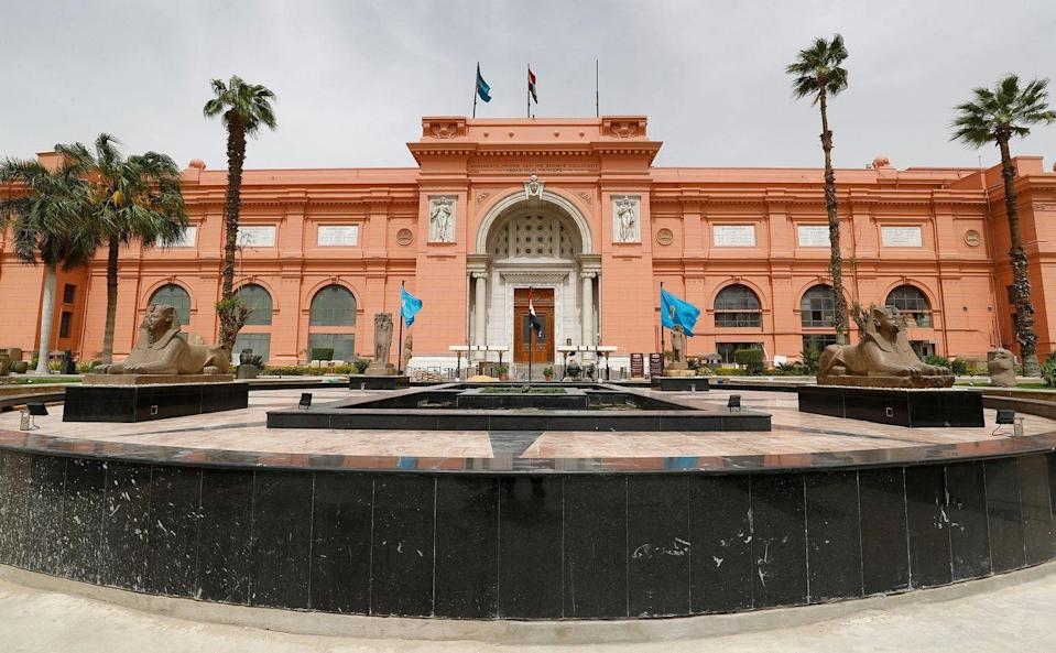 """<p>Commonly known as the <a href=""""http://www.sca-egypt.org/eng/mus_egyptian_museum.html"""" rel=""""nofollow noopener"""" target=""""_blank"""" data-ylk=""""slk:Egyptian Museum"""" class=""""link rapid-noclick-resp"""">Egyptian Museum</a> or the Museum of Cairo, this edifice is home to an extensive collection of antiquities, with over 120,o00 items and the world's largest collection of Pharaonic pieces. This Neoclassical building was designed by French architect Marcel Dourgnon and built by Italian construction company Garozzo-Zaffarani in 1901; construction is underway for a new building to house the Grand Egyptian Museum, set to open to the public in 2021.</p>"""