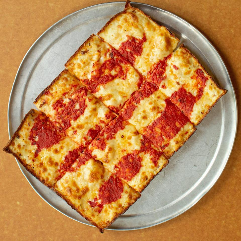 """<p>Stop at <a href=""""https://www.buddyspizza.com/"""" rel=""""nofollow noopener"""" target=""""_blank"""" data-ylk=""""slk:Buddy's"""" class=""""link rapid-noclick-resp"""">Buddy's</a> for a famous square pie, which they introduced in Detroit in 1946. The dough is first topped with pepperoni, then covered edge to edge with cheese, drizzled with red sauce (yes, on <em>top</em> of the cheese!) and baked until the edges are crisped and browned just right.</p>"""