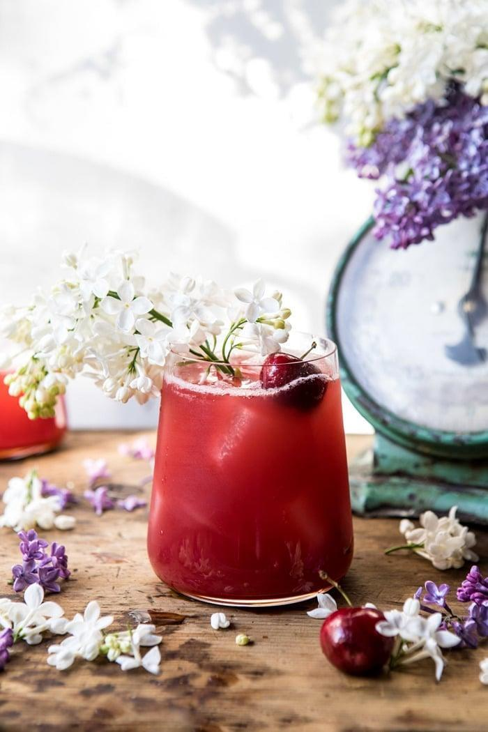 """<p>Who could possibly pass up this gorgeous drink? Infused with fresh cherries, honey, pineapple juice, and dried hibiscus flowers, it's basically a blessing for your taste buds. Fill each drink to the top, and garnish with hibiscus stems.</p> <p><strong>Get the recipe:</strong> <a href=""""https://www.halfbakedharvest.com/hibiscus-cherry-vodka-spritz/"""" class=""""link rapid-noclick-resp"""" rel=""""nofollow noopener"""" target=""""_blank"""" data-ylk=""""slk:hibiscus cherry vodka spritz"""">hibiscus cherry vodka spritz</a></p>"""