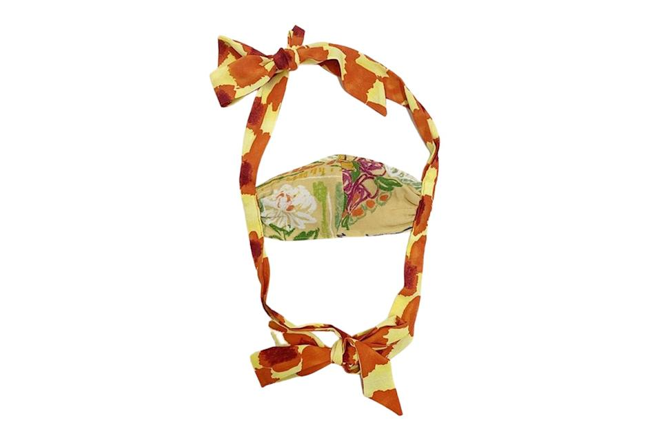 "$100, Collina Strada. <a href=""https://collinastrada.com/collections/accessories/products/fashion-face-mask-with-bows"" rel=""nofollow noopener"" target=""_blank"" data-ylk=""slk:Get it now!"" class=""link rapid-noclick-resp"">Get it now!</a>"