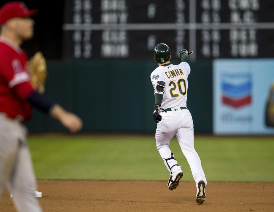 Oakland Athletics Mark Canha gestures as he runs the bases after hitting a two-run home run against the Los Angeles Angels in the fourth inning of a baseball game, Saturday, March 30, 2019 in Oakland, Calif. (AP Photo/John Hefti)