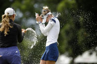 Nelly Korda, right, is doused by her sister, Jessica Korda, on 18th green after winning the Meijer LPA Classic golf tournament, Sunday, June 20, 2021, in Grand Rapids, Mich. (AP Photo/Al Goldis)