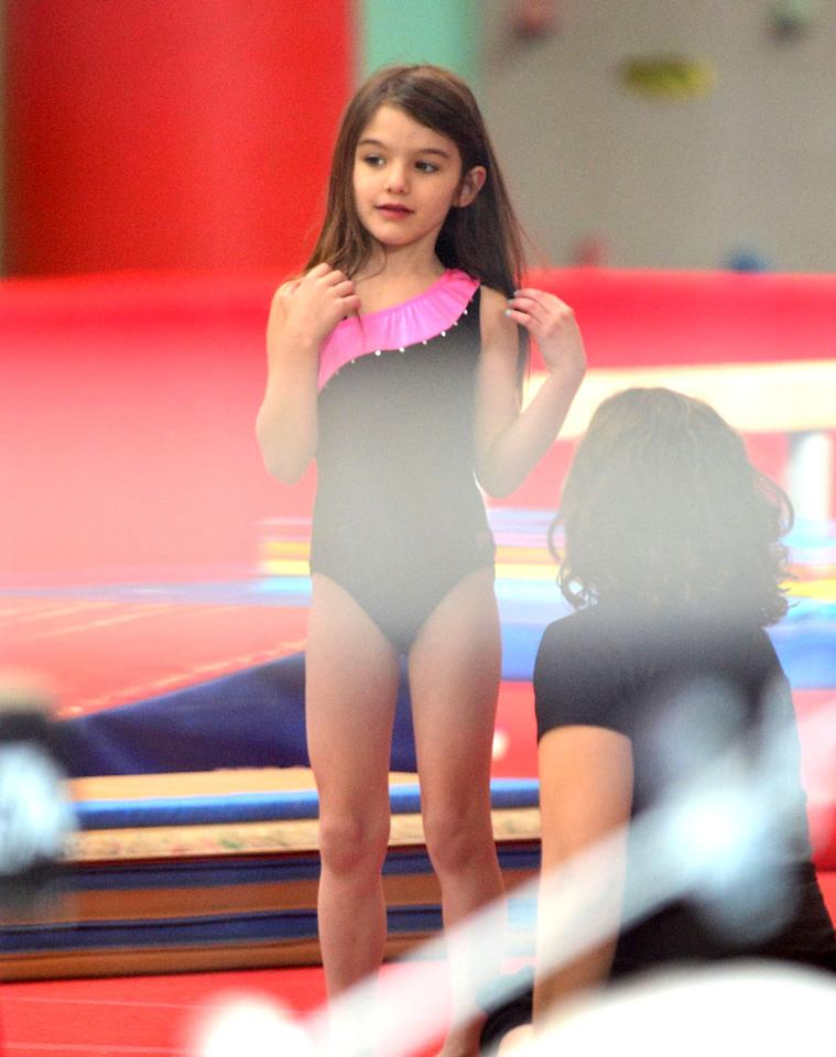 The cute kid got in a private gymnastics lesson at sports and entertainment complex Chelsea Piers. Might the family make a trip to London this summer so Suri can see some real-life Olympic gymnasts at work? (3/27/2012)