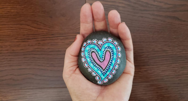 The Abundant Love Project and one of their artists' rocks