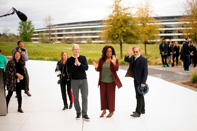 Apple CEO Tim Cook (L), Oprah Winfrey (C) and director Steven Spielberg stand for a photo during an event launching Apple tv+ at Apple headquarters on March 25, 2019, in Cupertino, California. (Photo by NOAH BERGER / AFP) (Photo credit should read NOAH BERGER/AFP/Getty Images)