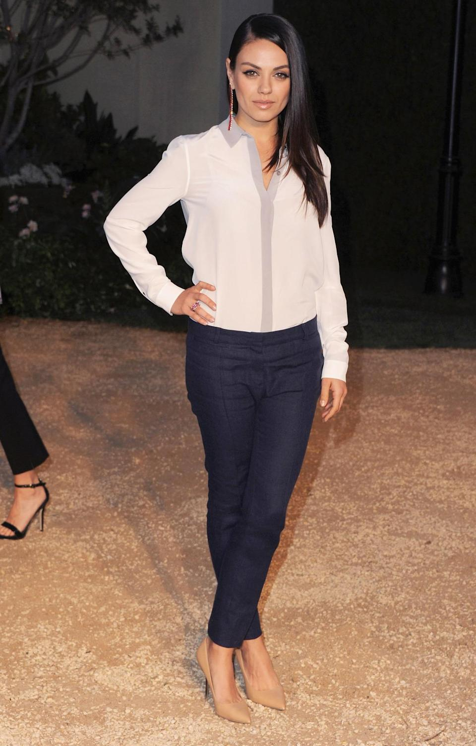 For mom's night out Mila Kunis wore denim trousers, a white button down blouse, and nude heels. With her hair straightened, makeup glowing, and statement earrings on, she amped up the daytime outfit for night.