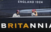 Ben Ainslie, left, skipper on Britain's INEOS Team UK races Italy's Luna Rossa to win race six of the Prada Cup on Auckland's Waitemata Harbour, New Zealand, Saturday, Feb.20, 2021. (Dean Purcell/NZ Herald via AP)