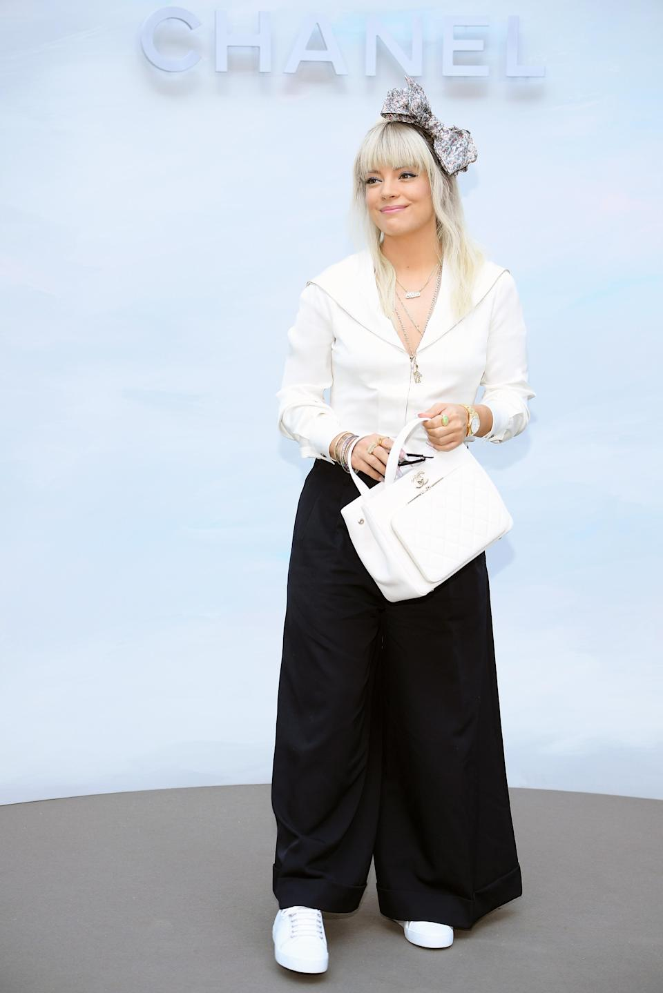 <p>Lily Allen kept it monochrome at Chanel's haute couture show on 3 July and accessorised the get-up with an Insta-worthy bow. <em>[Photo: Getty]</em> </p>