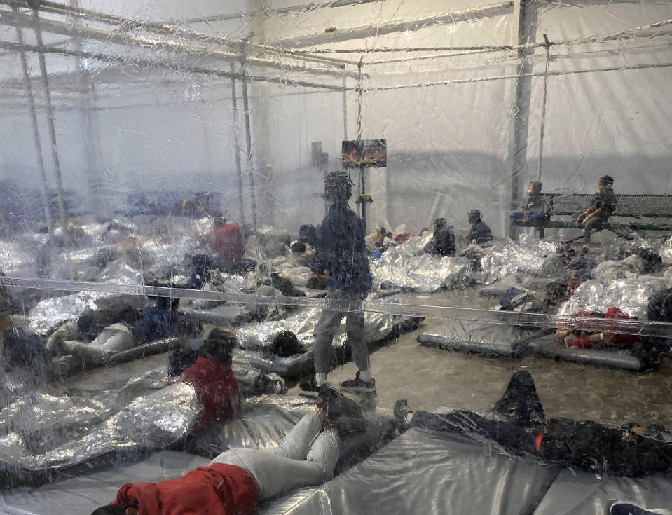 This March 20, 2021, photo provided by the Office of Rep. Henry Cuellar, D-Texas, shows detainees in a Customs and Border Protection (CBP) temporary overflow facility in Donna, Texas. President Joe Biden's administration faces mounting criticism for refusing to allow outside observers into facilities where it is detaining thousands of immigrant children.  (Photo courtesy of the Office of Rep. Henry Cuellar via AP)