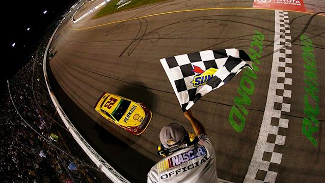 Amidst a four-car battle for the lead, Joey Logano slips through for Richmond win
