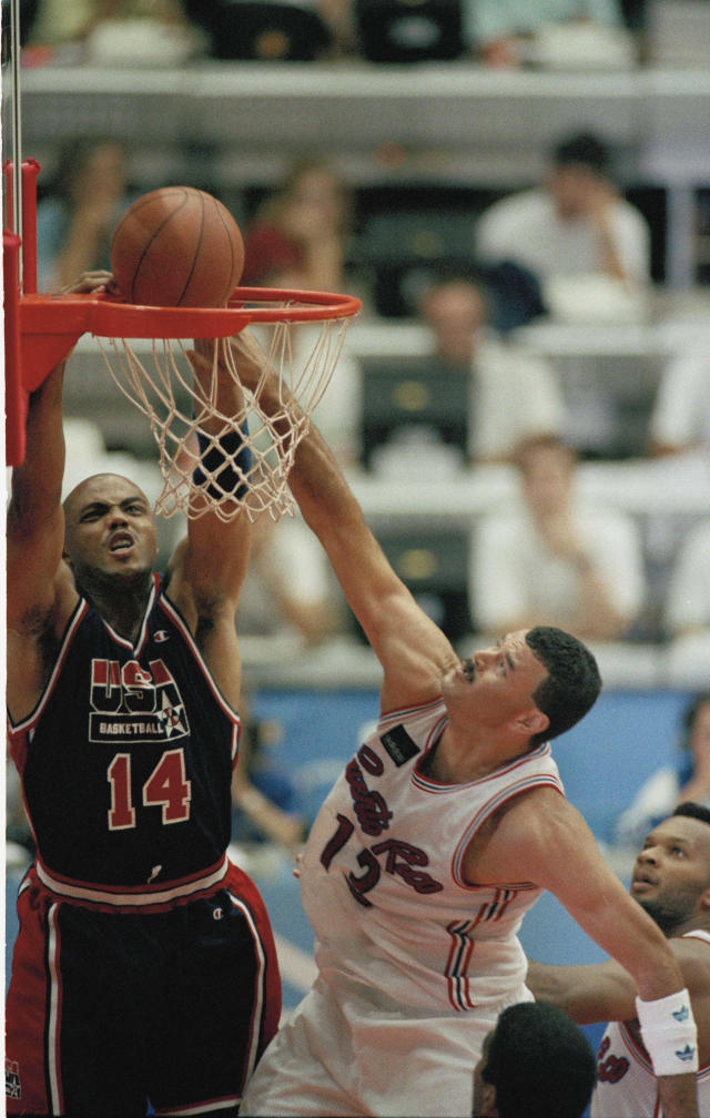 U.S.A. team's Charles Barkley slams the ball as Puerto Rico's Edgar DeLeon attempts to defend during their game at the XXV Summer Olympics in Barcelona, Aug. 4, 1992. The U.S. won, 115-77. (AP Photo/Susan Ragan)