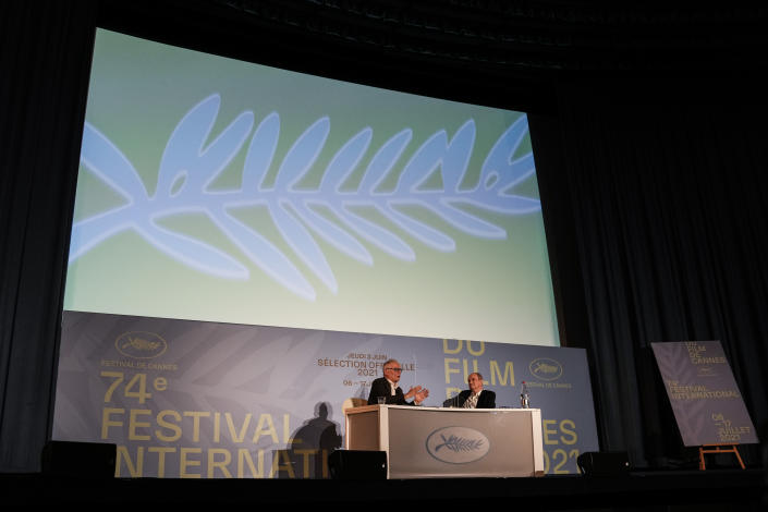 Festival director Thierry Fremaux, left and Festival president Pierre Lescure speak during the press conference for the presentation of the official selection of the 74th International Cannes Film Festival, in Paris, Thursday, June 3, 2021. (AP Photo/Francois Mori)