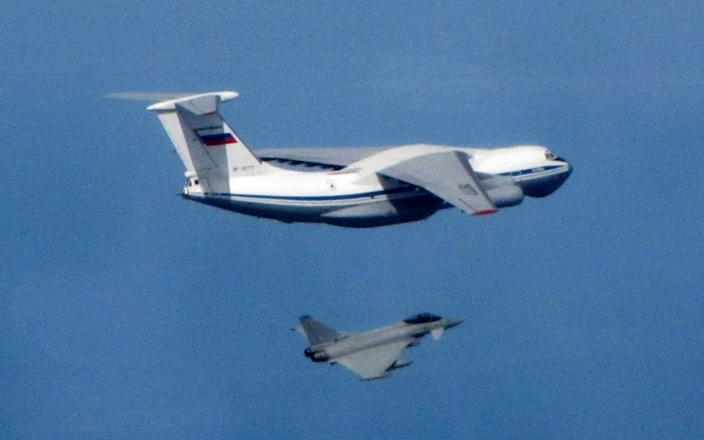 A Russian Air Force IL-76 Candid aircraft being shepherded near Nato airspace by an RAF Typhoon fighter that had scrambled from the Amari air base in Estonia. - RAF