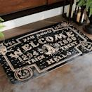 <p>This <span>Black Spirit Board Hooked Door Mat</span> ($100) is the ideal welcome to a haunted house.</p>