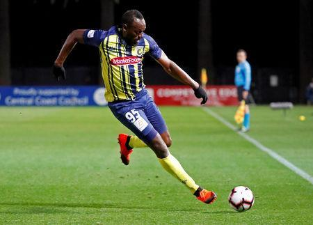 FILE PHOTO: Soccer Football - Central Coast Mariners v Central Coast Select - Central Coast Stadium, Gosford, Australia - August 31, 2018 Central Coast Mariners' Usain Bolt in action REUTERS/David Gray