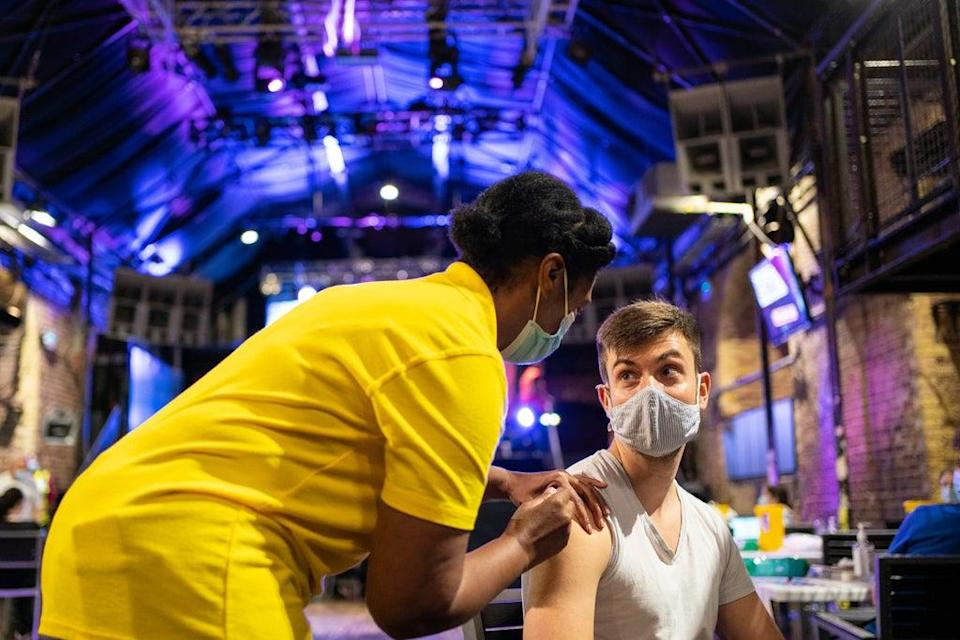 Nathaniel McVeigh receives a dose of the Pfizer/BioNTech Covid-19 vaccine at Heaven nightclub in central London (Dominic Lipinski/PA) (PA Wire)