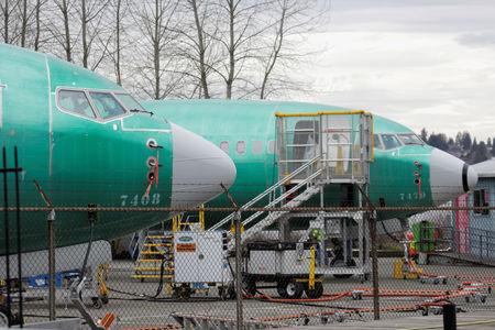 Two Boeing 737 MAX 8 aircraft are parked at a Boeing production facility in Renton, Washington