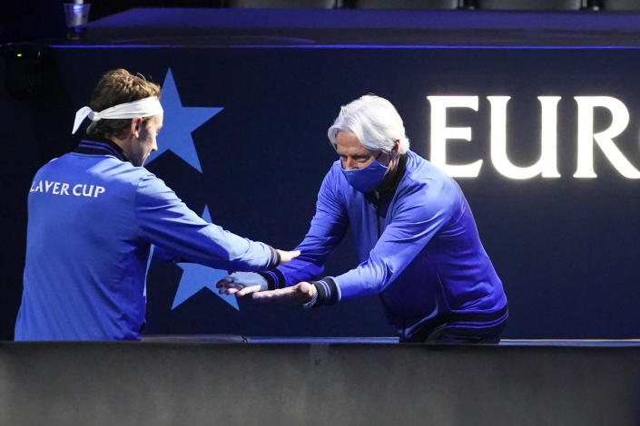 Europe's captain Bjorn Borg, right, greets Casper Ruud, of Norway, prior to his match at Laver Cup tennis, Friday, Sept. 24, 2021, in Boston. (AP Photo/Elise Amendola)