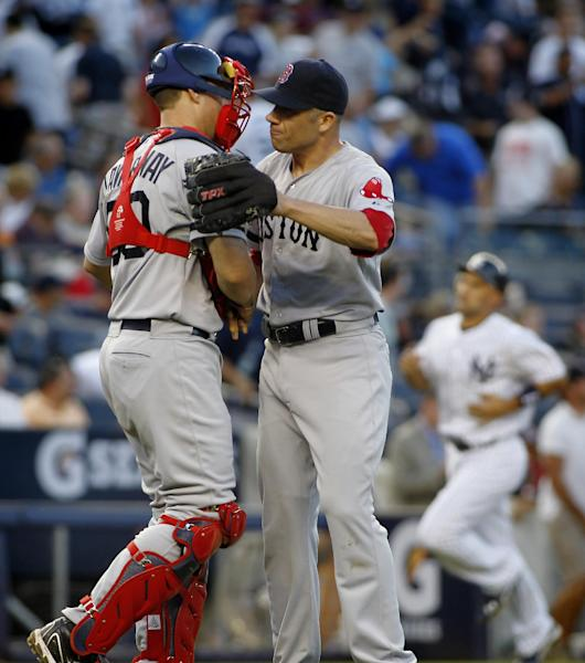 Boston Red Sox's Ryan Lavarnway (60) congratulates pitcher Alfredo Aceves, right, after he closed out the New York Yankees in the ninth inning of a baseball game, Saturday, Aug. 18, 2012, at Yankee Stadium in New York. The Red Sox defeated the Yankees 4-1. (AP Photo/John Dunn)