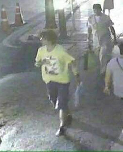 CCTV footage shows a possible suspect involved in the Bangkok bomb blast, seen close to the Erawan shrine on August 17, 2015 (AFP Photo/)