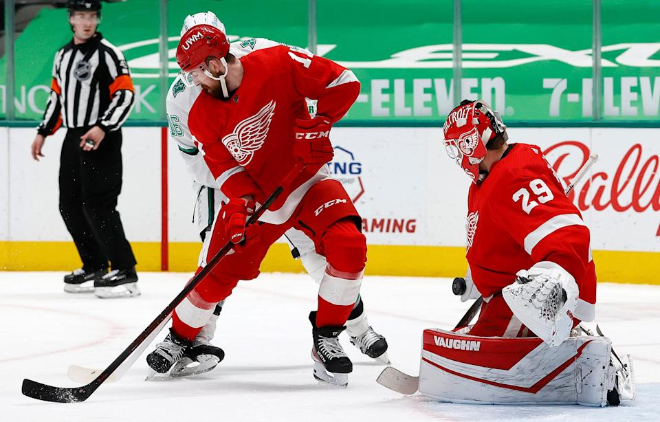 Red Wings goalie Thomas Greiss blocks a shot on goal against the Stars in the second period on Monday, April 19, 2021, in Dallas.