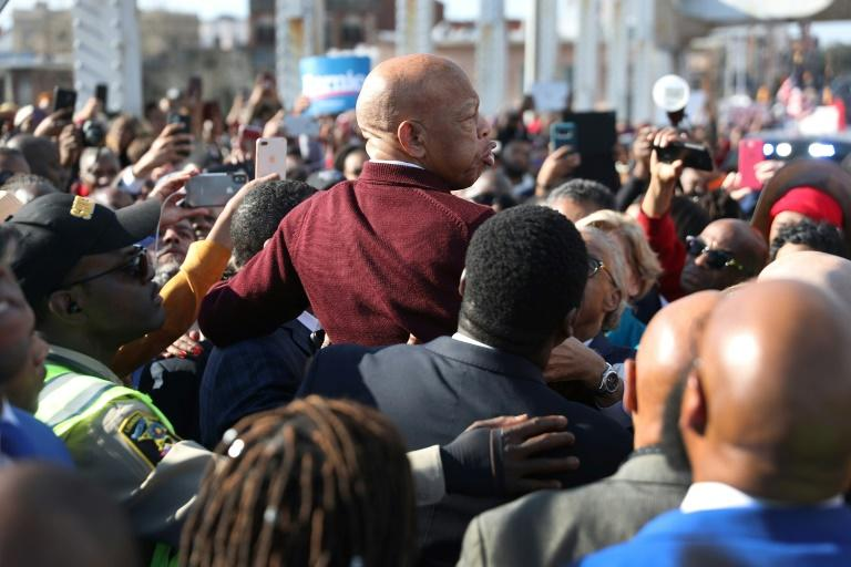 """While attending the 55th annivesrary of """"Bloody Sunday"""" on March 1, 2020, Congressman John Lewis was hoisted on the shoulders of two supporters and told the crowd, """"We cannot give up now, we cannot give in"""""""