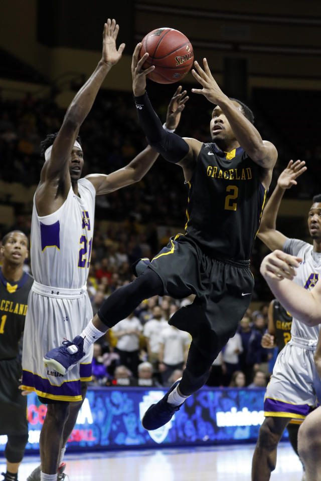 Graceland guard LT Davis (2) attempts to score as LSU Alexandria forward Brandon Moss (21) defends during the first half of the NAIA men's championship college basketball game Tuesday, March 20, 2018, in Kansas City, Mo. (AP Photo/Colin E. Braley)
